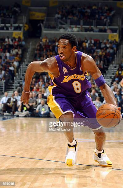 Guard Kobe Bryant of the Los Angeles Lakers dribbles the ball during the NBA game against the Washington Wizards at MCI Center in Washington District...