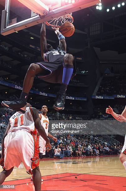Guard Ricky Davis of the Cleveland Cavaliers dunks over point guard Jacque Vaughn of the Atlanta Hawks during the NBA game at Philips Arena in...