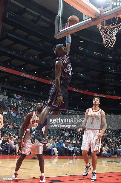 Guard Ricky Davis of the Cleveland Cavaliers dunks the ball during the NBA game against the Atlanta Hawks at Philips Arena in Atlanta Georgia The...