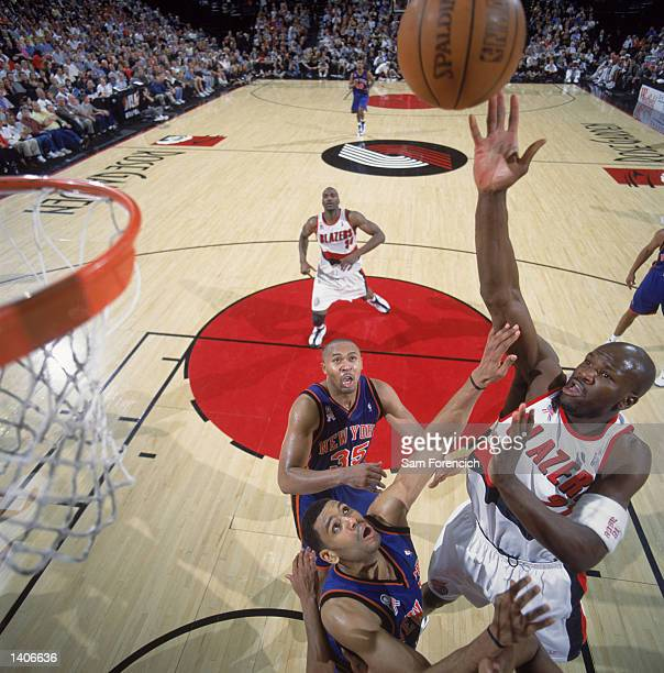 Guard Ruben Patterson of the Portland Trail Blazers shoots the ball over forward Kurt Thomas of the New York Knicks during the NBA game at the Rose...