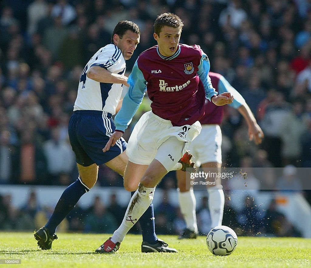 Gustavo Poyet of Tottenham Hotspur tries to tackle Michael Carrick of West Ham during the FA Barclaycard Premiership match between Tottenham Hotspur and West Ham United at White Hart Lane, London. DIGITAL IMAGE Mandatory Credit: Ben Radford/Getty Images