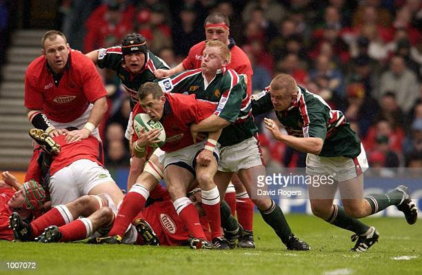 Guy Easterby of Llanelli is stopped by Dorian West of Leicester during the Heineken Cup Semi Final match between Leicester Tigers and Llanelli at The...