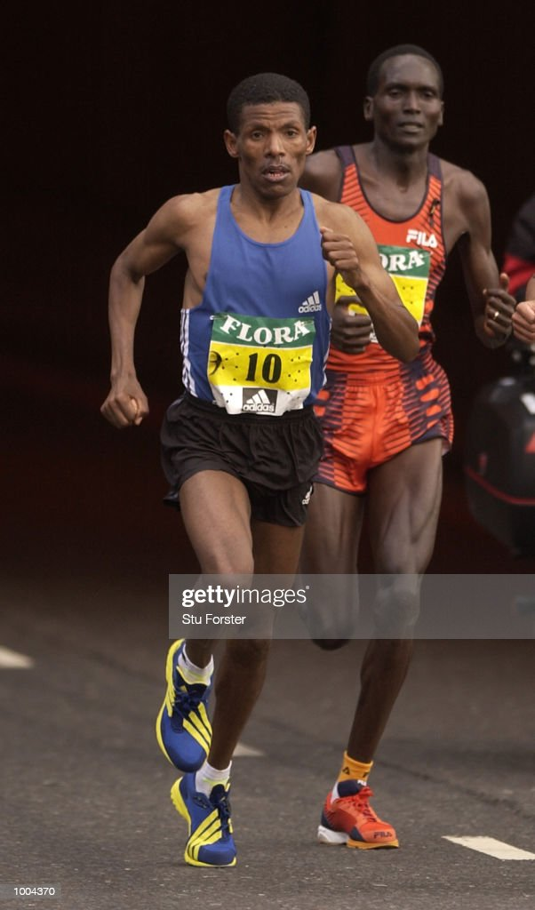 Haile Gebrselassie (left) with Paul Tergat of Kenya during the Flora London Marathon in London. DIGITAL IMAGE. Mandatory Credit: Stu Forster/Getty Images