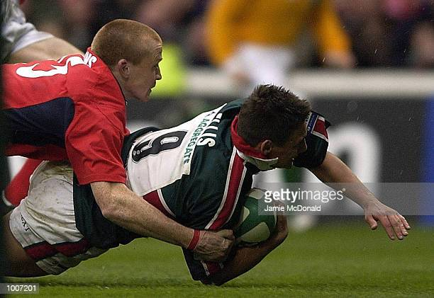 Harry Ellis of Leicester slides over to score a try during the Heineken Cup Semi Final match between Leicester Tigers and Llanelli at The City Ground...