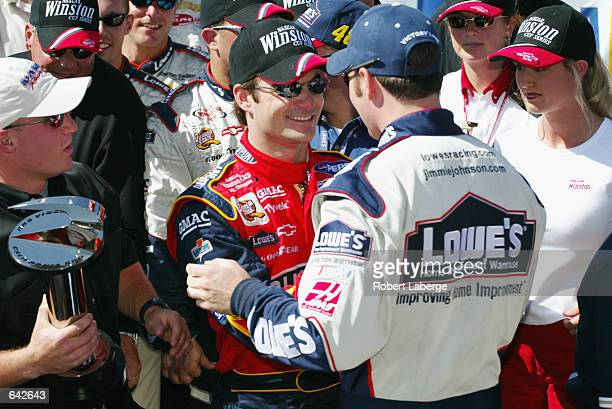 Hendrick Motorsports driver Jimmie Johnson is congratulated by co-owner Jeff Gordon after winning the NASCAR Winston Cup Series NAPA Auto Parts 500...