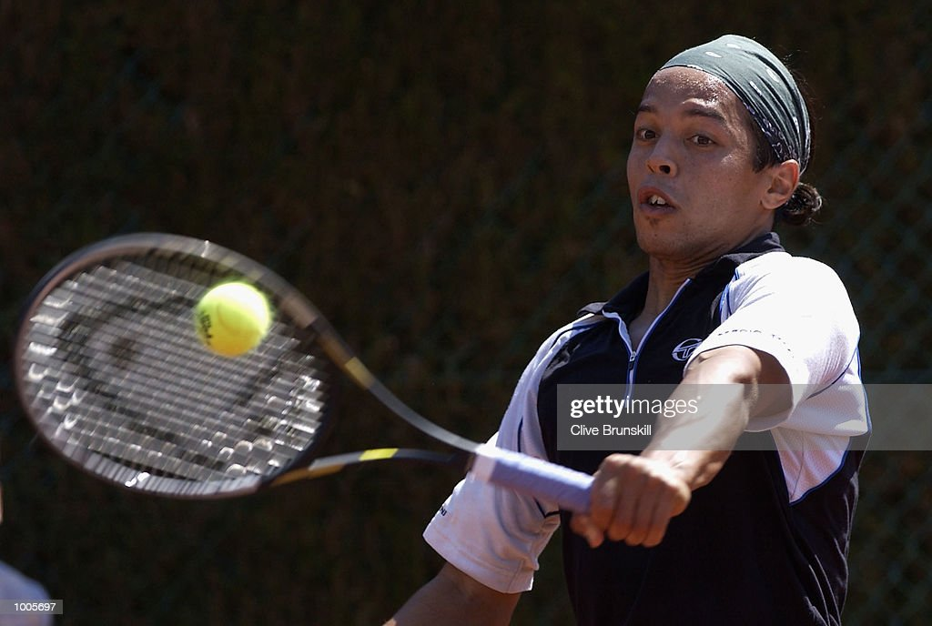 Hicham Arazi of Marocco plays a backhand during his first round match against Zeljko Krajan of Croatia during the Open Seat Godo,Barcelona, Spain . DIGITAL IMAGE Mandatory Credit: Clive Brunskill/Getty Images