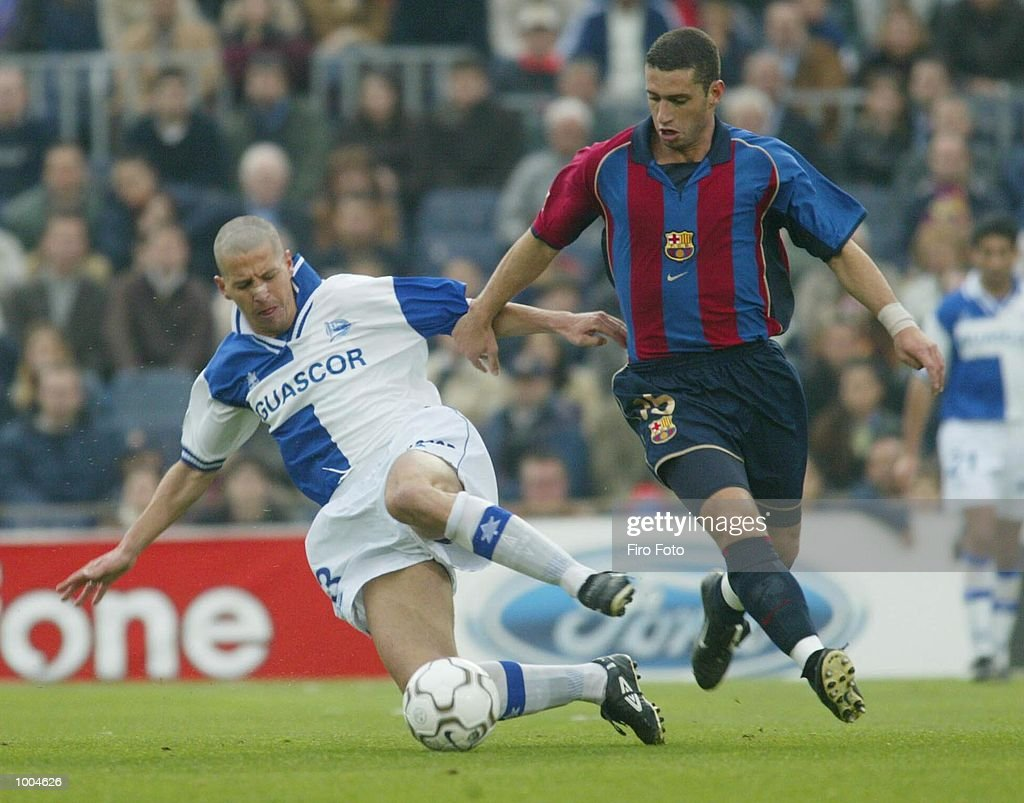 Ibon Begona of Alaves and Fabio Rochemback of Barcelona in action during the Primera Liga match between Barcelona and Alaves, played at the Camp Nou Stadium, Barcelona. DIGITAL IMAGE. Mandatory Credit: Firo Foto/Getty Images