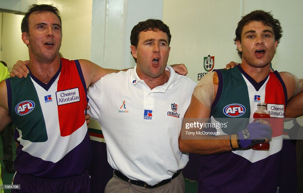 Jason Norrish #25, Chris Connolly and Troy Longmuir #21 for the Fremantle Dockers celebrate their win after the round two AFL match between the Fremantle Dockers and St Kilda Saints played at Subiaco Oval in Western Australia.Mandatory Credit: Tony McDonough/Getty Images