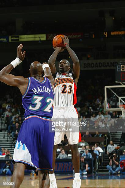 Jason Richardson of the Golden State Warriors puts a shot up over Karl Malone of the Utah Jazz during their game at the Arena in Oakland in Oakland...