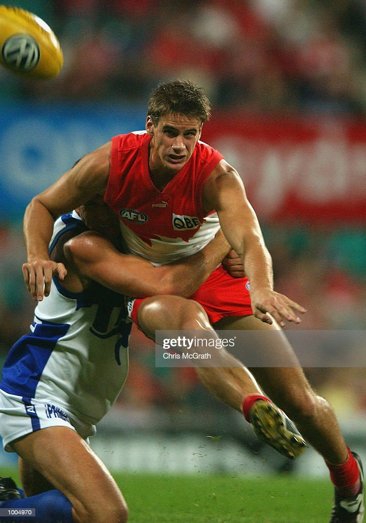 Jason Saddington #22 of the Swans gets a kick away during the round 4 AFL match between the Sydney Swans and the Kangaroos held at the Sydney Cricket Ground, Sydney, Australia. DIGITAL IMAGE. Mandatory Credit: Chris McGrath/Getty Images