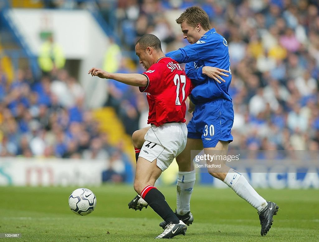 Jesper Gronkjer of Chelsea tries to tackle Mikael Silvestre of Manchester United during the FA Barclaycard Premiership match between Chelsea and Manchester United at Stamford Bridge, London. DIGITAL IMAGE Mandatory Credit: Ben Radford/Getty Images