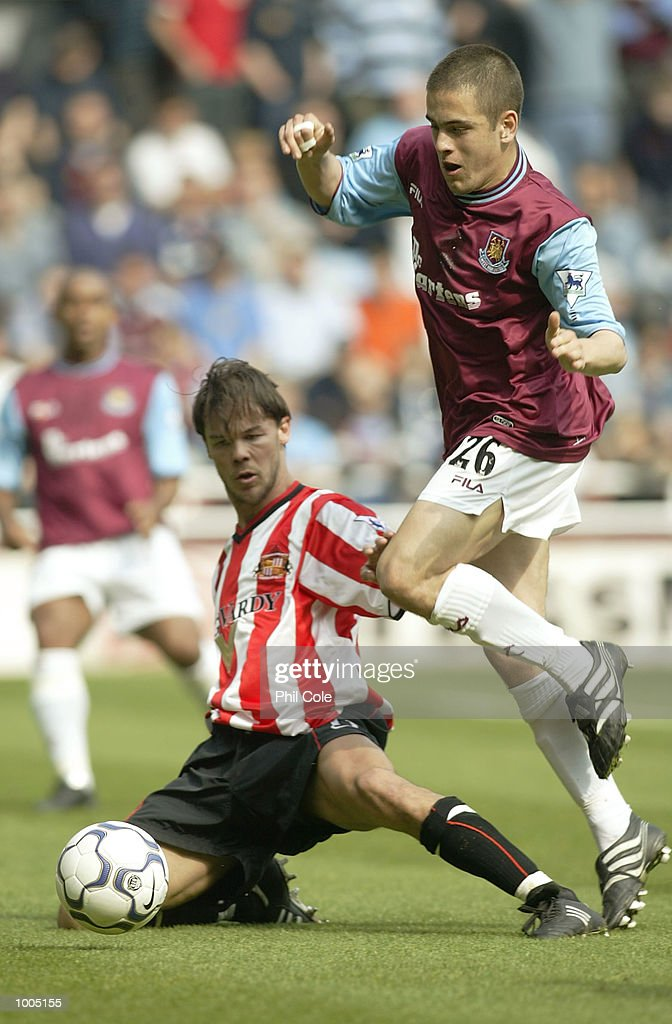 Joe Cole of West Ham evedes a tackle from Joachim Bjorkland of Sunderland during the FA Barclaycard Premiership match between West Ham United and Sunderland at Upton Park, London. DIGITAL IMAGE. Mandatory Credit: Phil Cole/Getty Images