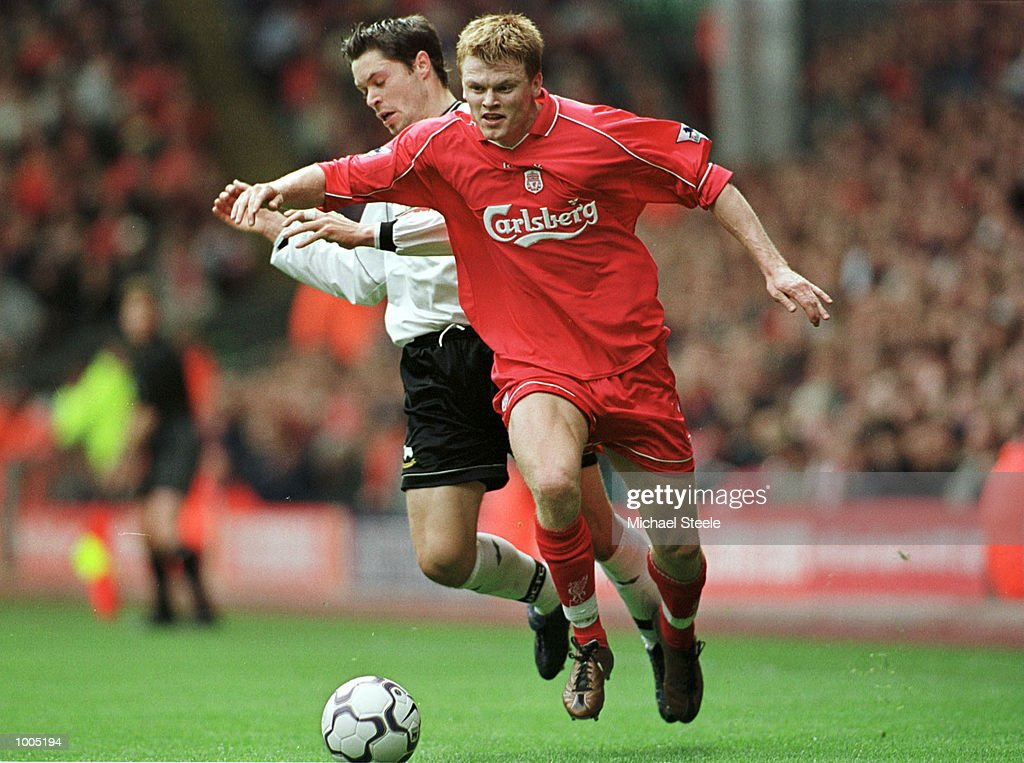 John Arna Riise of Liverpool clashes with Malcolm Christie of Derby during the Liverpool v Derby County FA Barclaycard Premeirship match at Anfield, Liverpool. Mandatory Credit: Michael Steele/Getty Images