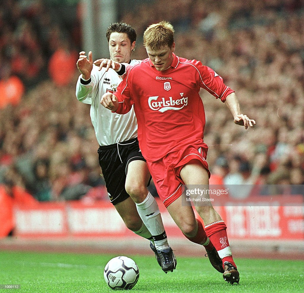 John Arne Riise of Liverpool battles with Malcolm Christie of Derby during the Liverpool v Derby County FA Barclaycard Premeirship match at Anfield, Liverpool. Mandatory Credit: Michael Steele/Getty Images