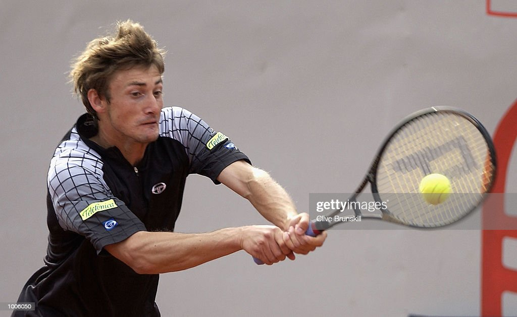 Juan Carlos Ferrero of Spain plays a backhand during his second round match against Jose Acasuso of Argentina during the Open Seat Godo 2002 held in Barcelona, Spain. DIGITAL IMAGE Mandatory Credit: Clive Brunskill/Getty Images