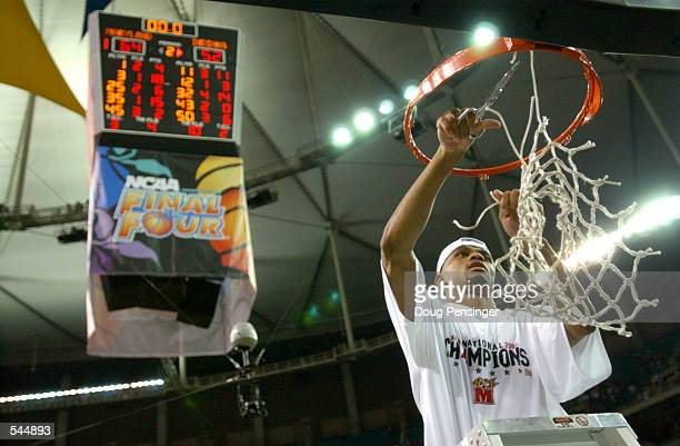 Juan Dixon of Maryland celebrates by cutting down the net after the men's NCAA National Championship game at the Georgia Dome in Atlanta, Georgia....