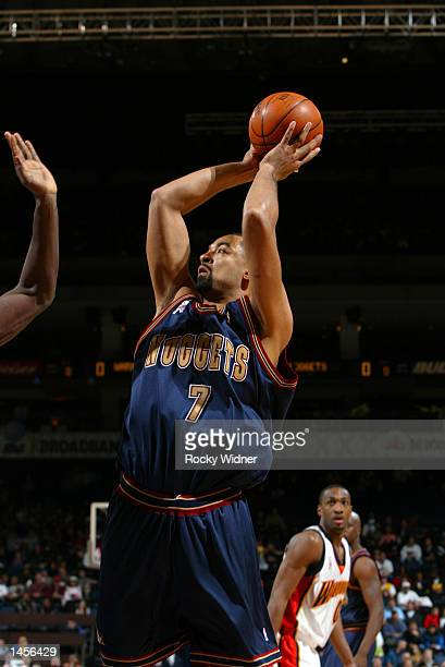 Juwan Howard of the Denver Nuggets shoots the ball against the Golden State Warriors at The Arena in Oakland California DIGITAL IMAGE NOTE TO USER...