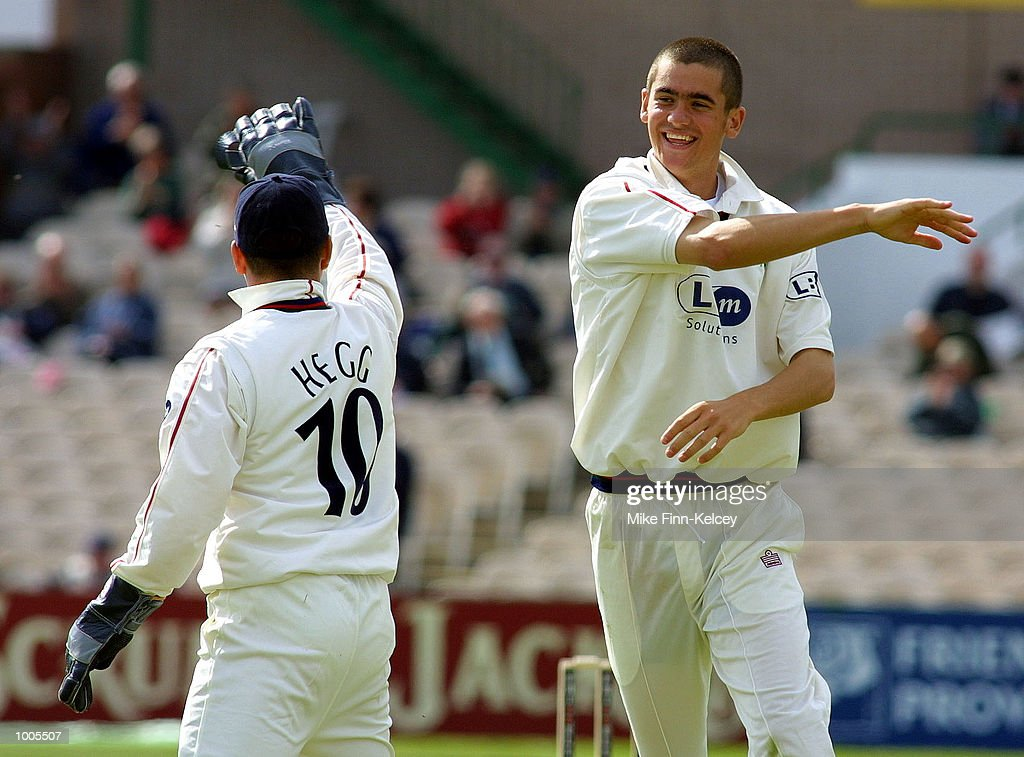 Karl Hogg of Lancashire celebrates with team-mate Warren Hegg after dismissing Phil De Freitas of Leicestershire in the Frizzell County Championship match at Old Trafford, Manchester. DIGITAL IMAGE Mandatory Credit: Mike Finn Kelcey/GettyImages