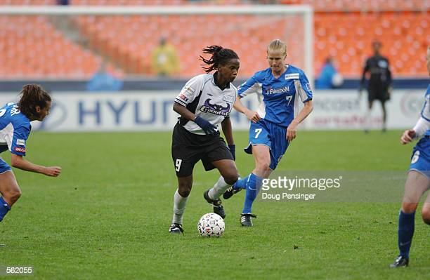katia of the San Jose Cyberrays runs with the ball against the Washington Freedom during the WUSA game at RFK Stadium in Washington DC The Freedom...