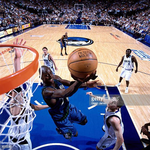 Kevin Garnett of the Minnesota Timberwolves drives to the basket for a reverse layup against the Dallas Mavericks during Game 2 of the Western...
