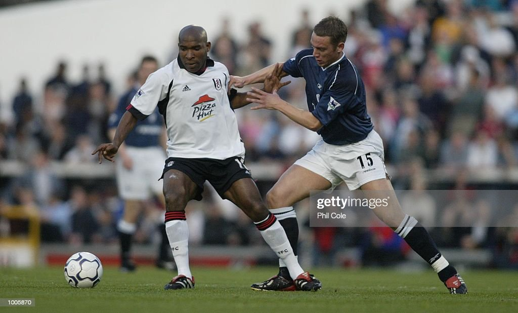 Kevin Nolan of Bolton Wanderers tries to tackle Barry Hayles of Fulham during the FA Barclaycard Premiership match between Fulham and Bolton Wanderers at Craven Cottage, London. DIGITAL IMAGE Mandatory Credit: Phil Cole/Getty Images