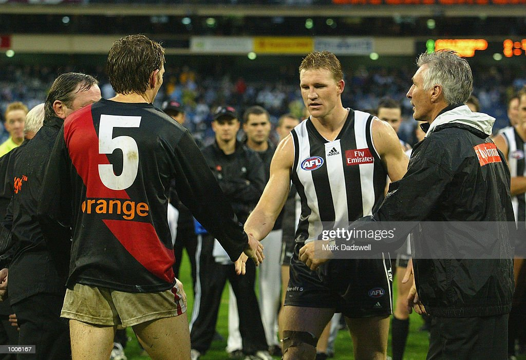 Kevin Sheedy coach of Essendon and James Hird #5 and captain of Essendon congratulate Nathan Buckley #5 and captain of Collingwood and Mick Malthouse coach of Collingwood, on their win in the Round 5 AFL Anzac Day match between the Collingwood Magpies and the Essendon Bombers, played at the MCG, Melbourne, Australia. DIGITAL IMAGE. Mandatory Credit: Mark Dadswell/Getty Images