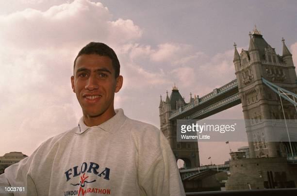 Khalid Khannouchi of USA poses in front of Tower Bridge during a press conference for the Flora London Marathon held at Tower Bridge London Mandatory...