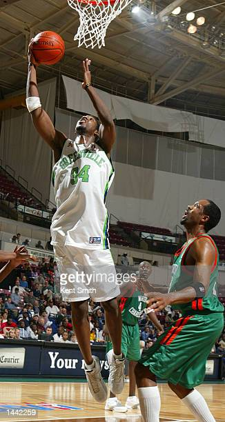 Kimani Ffriend of the Greenville Groove goes for the slam dunk against Sedric Webber#23 of the North Charleston Lowgators in Game 2 of the NBDL...