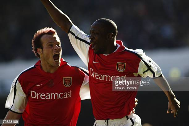Lauren of Arsenal celebrates scoring the winning goal from the penalty spot with teammate Fredrik Ljungberg during the FA Barclaycard Premiership...