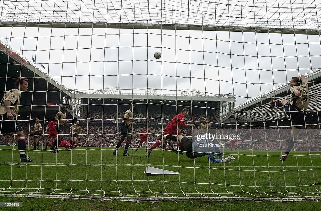 Lee Dixon of Arsenal clears the ball off the line during the AXA FA Cup Semi Final between Arsenal and Middlesbrough at Old Trafford, Manchester. DIGITAL IMAGE. Mandatory Credit: Ross Kinnaird/Getty Images