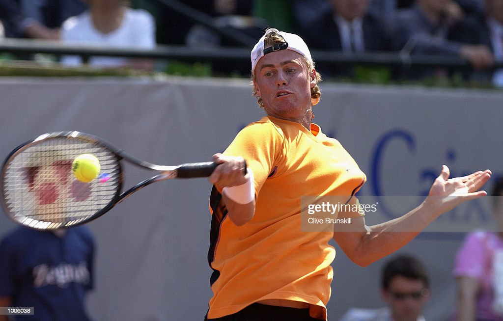 Lleyton Hewitt of Australia plays a forehand during his second round match against Marc Lopez of Spain during the Open Seat Godo 2002 held in Barcelona, Spain. DIGITAL IMAGE Mandatory Credit: Clive Brunskill/Getty Images