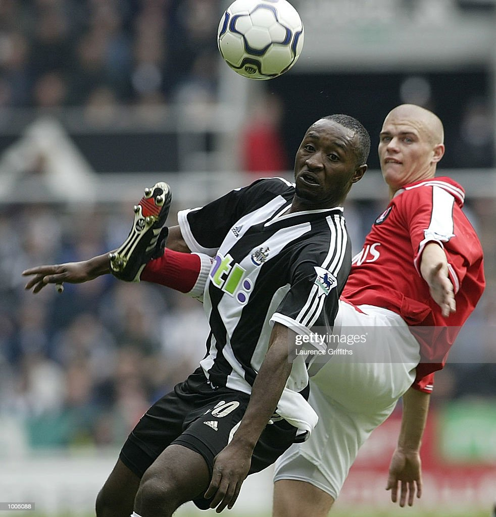Lomana Lualua of Newcastle battles with Paul Konchesky of Charlton during the Newcastle United v Charlton Athletic FA Barclaycard Premiership match at St James Park, Newcastle. DIGITAL IMAGE Mandatory Credit: Laurence Griffiths/Getty Images