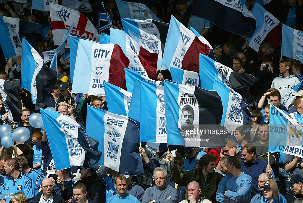 Man City fans celebrate his celebrate winning the First Division Championship during the Nationwide First Division game between Manchester City and Portsmouth at Maine Road, Manchester. DIGITAL IMAGE. Mandatory Credit: Alex Livesey/Getty Images