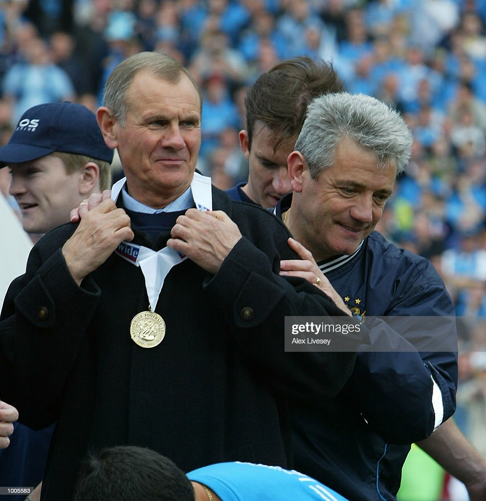 Man City manager, Kevin Keegan and assistant Arthur Cox celebrate winning the First Division Championship after the Nationwide First Division game between Manchester City and Portsmouth at Maine Road, Manchester. DIGITAL IMAGE. Mandatory Credit: Alex Livesey/Getty Images