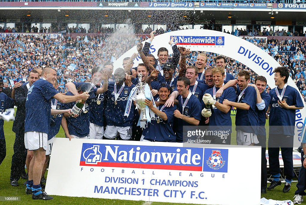 Man City team celebrate winning the First Division Championship after the Nationwide First Division game between Manchester City and Portsmouth at Maine Road, Manchester. DIGITAL IMAGE. Mandatory Credit: Alex Livesey/Getty Images