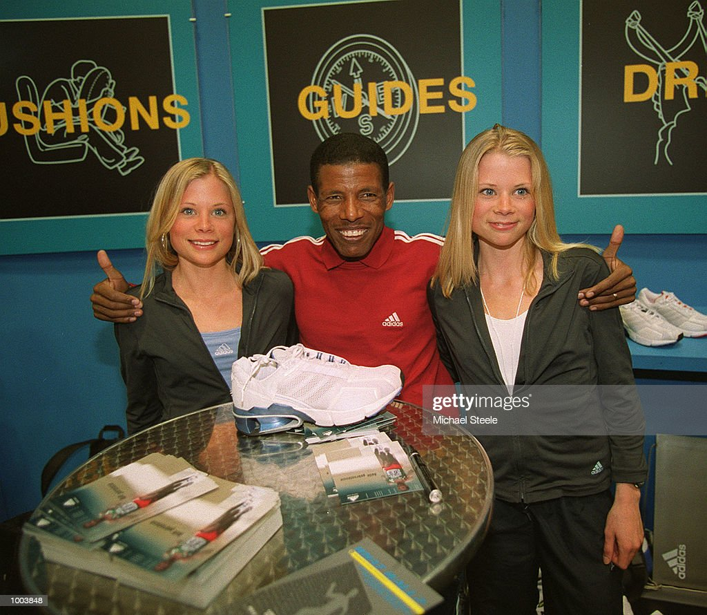 Marathon debutant Haile Gebrselassie (left) of Ethiopia poses withthe UK number 1 and 2 ranked cross country runners and twin sisters Briony and Kathryn Frost at the adidas stand at the London Marathon Exhibition at the London Arena in Docklands, London. Mandatory Credit: Michael Steele/Getty Images