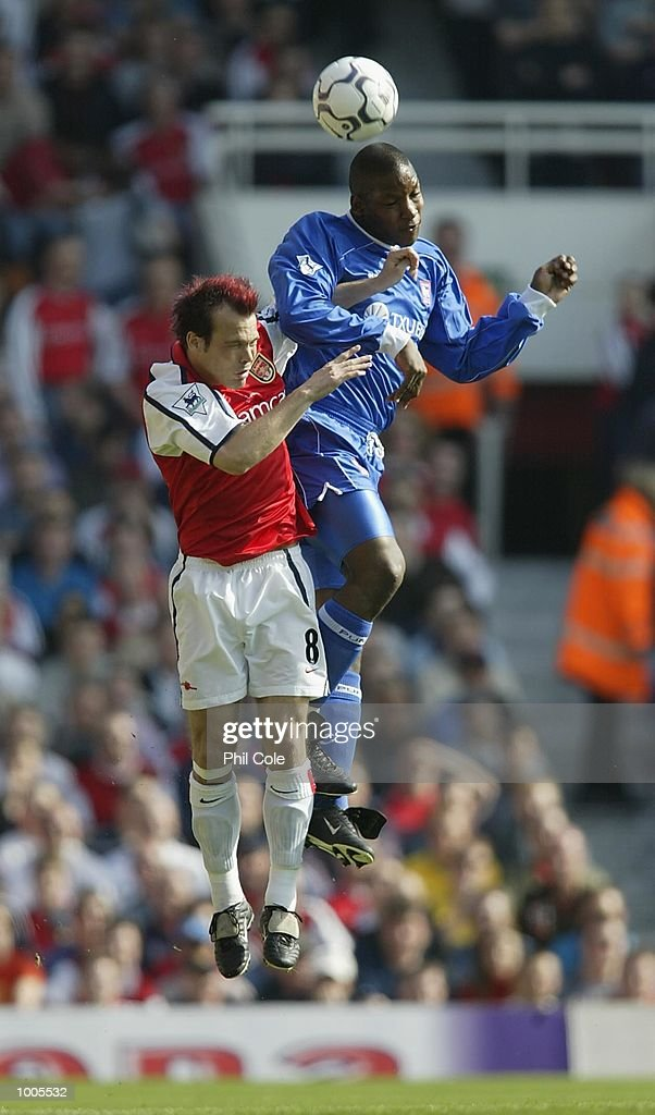 Marcus Bent of Ipswich Town and Fredrik Ljungberg of Arsenal in action during the FA Barclaycard Premiership match between Arsenal and Ipswich Town at Highbury, London. DIGITAL IMAGE Mandatory Credit: Phil Cole/Getty Images