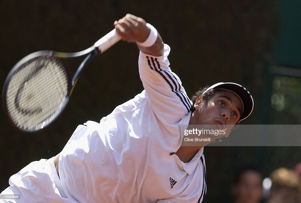 Mariano Zabaleta of Argentina serves in his first round match against David Sanchez of Spain during the Open Seat Godo 2002 held in Barcelona, Spain. DIGITAL IMAGE Mandatory Credit: Clive Brunskill/Getty Images