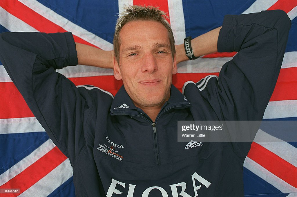 Mark Steinle of Great Britain poses with a Union Jack during a press conference for the Flora London Marathon held at Tower Bridge, London. Mandatory Credit: Warren Little/Getty Images