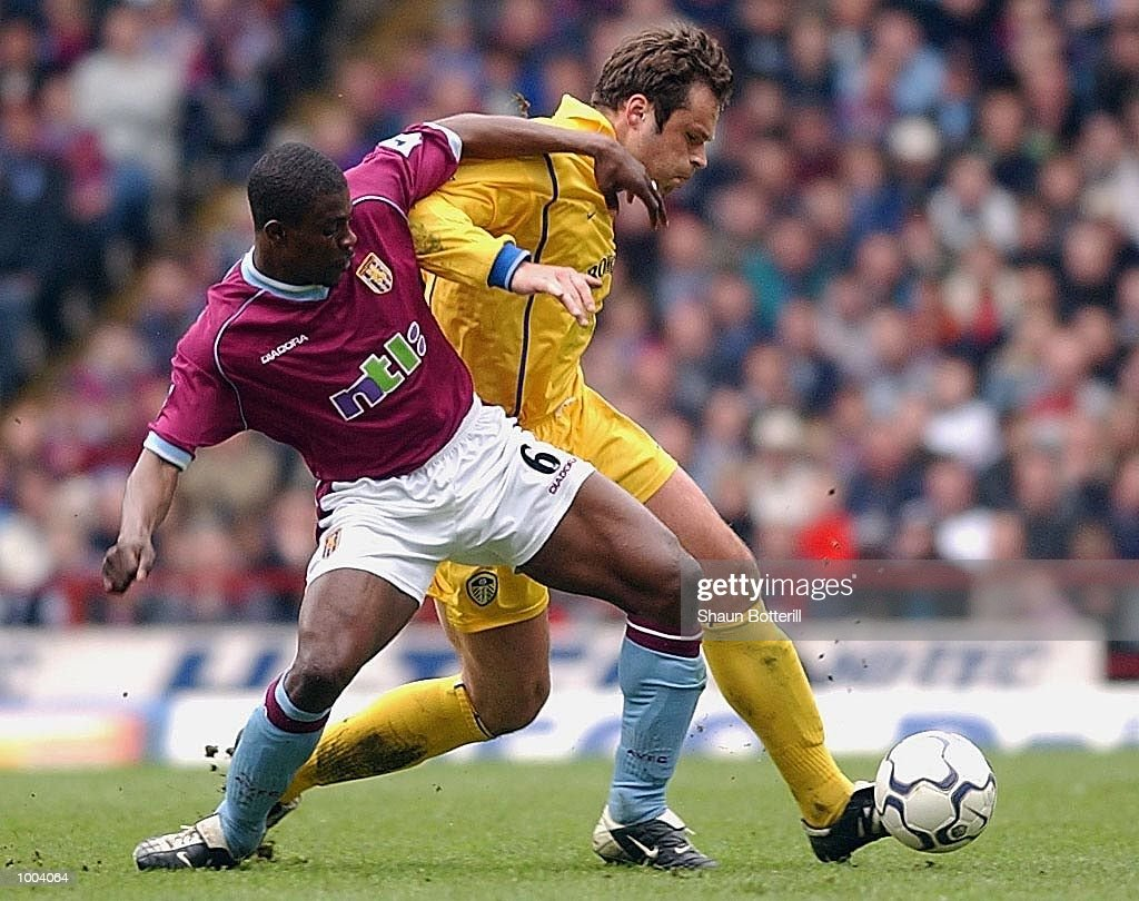 Mark Viduka of Leeds ibattles for the ball with George Boateng of Villa during the FA Barclaycard Premiership match between Aston Villa and Leeds United at Villa Park, Birmingham. DIGITAL IMAGE. Mandatory Credit: Shaun Botterill/Getty Images