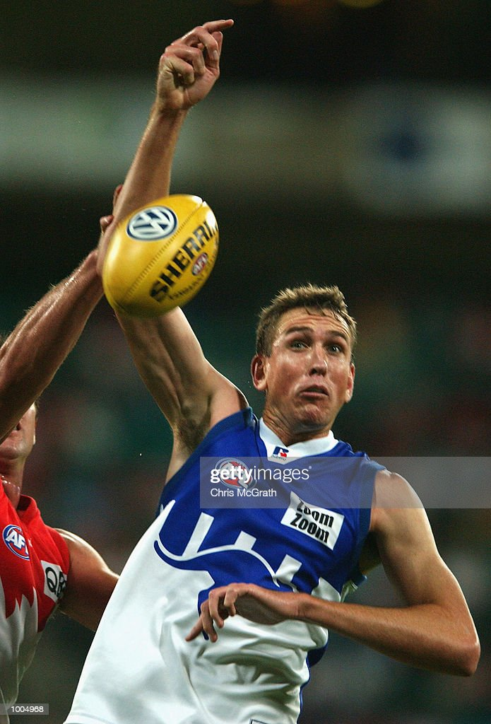 Matthew Burton #22 of the Kangaroos in action during the round 4 AFL match between the Sydney Swans and the Kangaroos held at the Sydney Cricket Ground, Sydney, Australia. DIGITAL IMAGE. Mandatory Credit: Chris McGrath/Getty Images