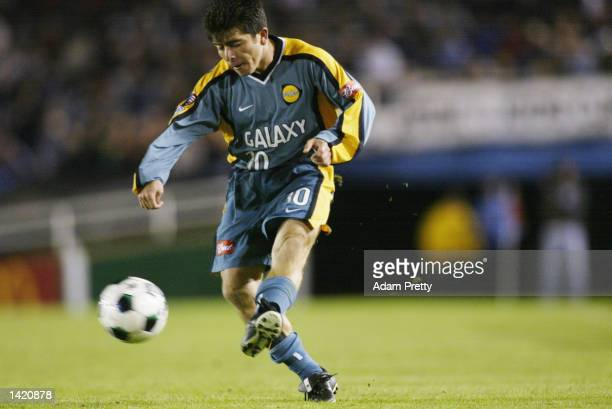 581a9309a6d Mauricio Cienfuegos of the Los Angeles Galaxy dribbles against the defense  of the Chicago Fire during