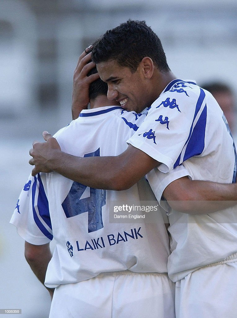 Mehmet Durakovic #4 and Patrick Kisnorbo #4 of South Melbourne celebrate winning 2 to1 against Brisbane during the NSL second leg of the Elimination Final series played between the Brisbane Strikers and South Melbourne played at Ballymore in Brisbane, Australia. DIGITAL IMAGE. Mandatory Credit: Darren England/Getty Images