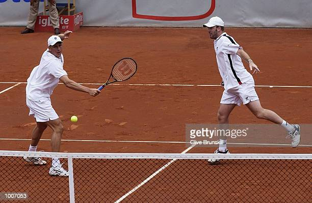 Michael Hill of Australia and Daniel Vacek of the Czech Republic in action during the doubles final against Gaston Etlis and Lucas Arnold of...