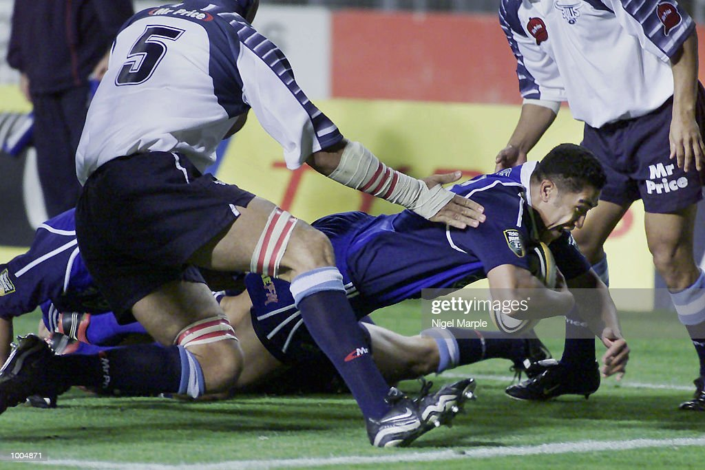 Mils Muliaina #15 of the Blues dives over for a try during the Super 12 game between the Blues and the Bulls at Eden Park Auckland, New Zealand. The Blues won 65-24. DIGITAL IMAGE. Mandatory Credit: Nigel Marple/Getty Images