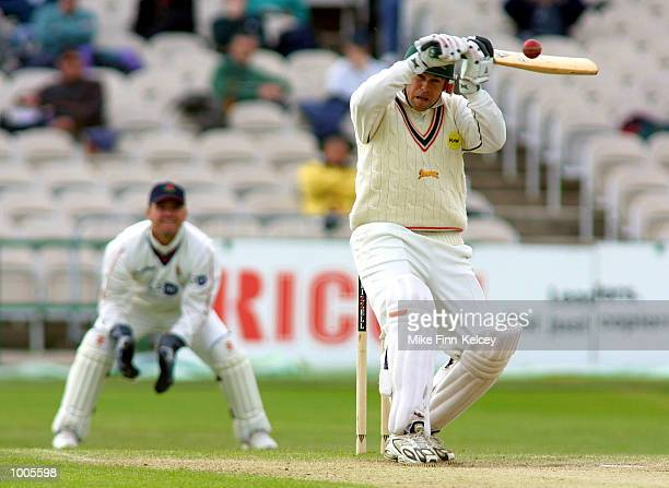 Neil Burns of Leicestershire hits out on his way to 62 against Lancashire in the Frizzell County Championship match at Old Trafford Manchester...