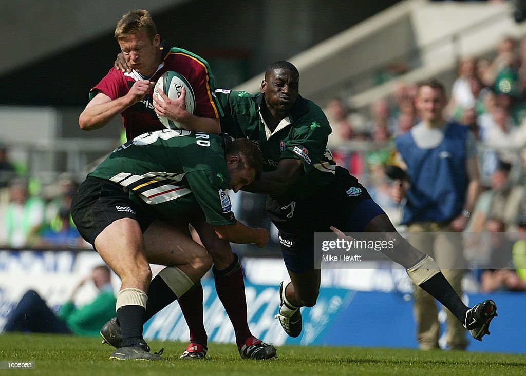 Nick Beal of Northampton is stopped by Geoff Appleford and Paul Sackey of London Irish during the Powergen Cup Final between Nothampton Saints and London Irish at Twickenham, London. DIGITAL IMAGE. Mandatory Credit: Mike Hewitt/Getty Images