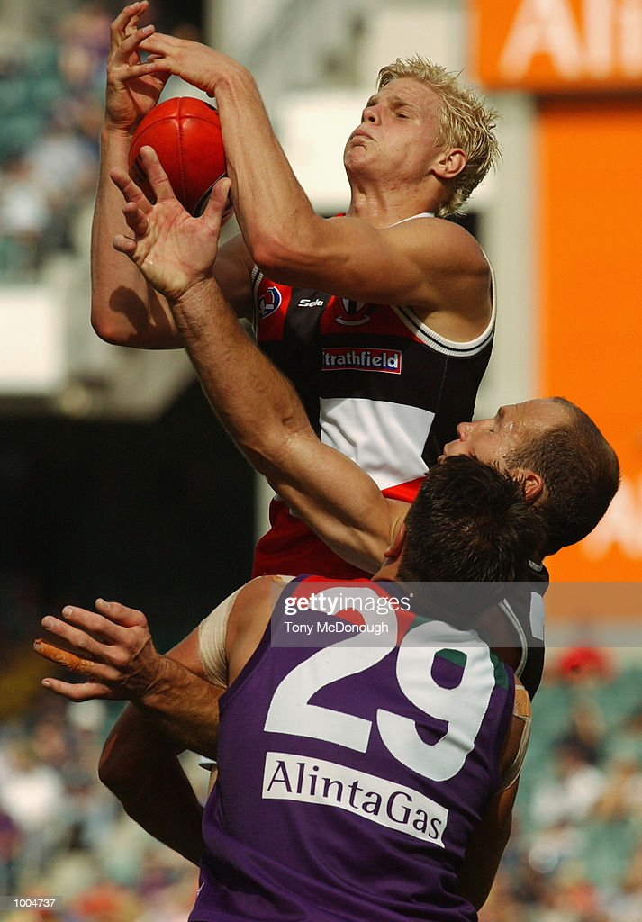 Nick Riewoldt #12 for St Kilda marks the ball over Stewart Lowe #23 for St Kilda and Matthew Pavlich #29 for Fremantle during the round two AFL match between the Fremantle Dockers and St Kilda Saints played at Subiaco Oval in Western Australia.Mandatory Credit: Tony McDonough/Getty Images