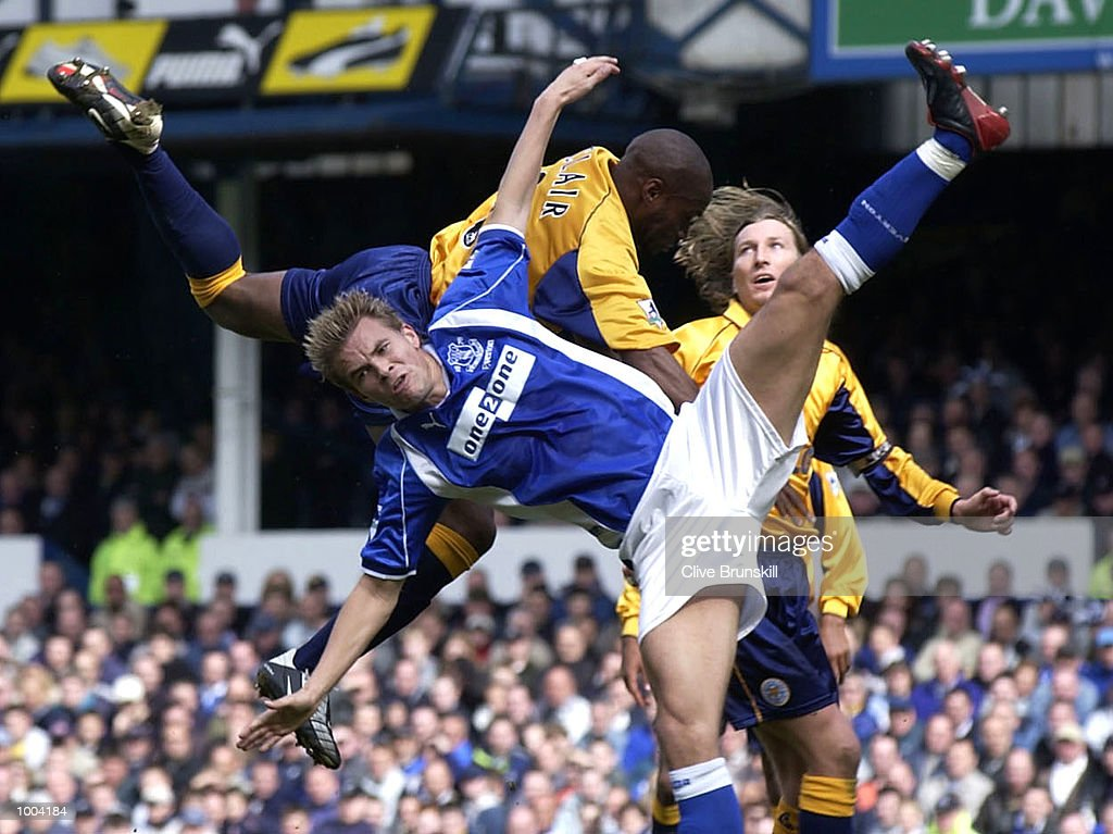 Niclas Alexandersson of Everton collides with Frank Sinclair of Leicester during the Everton v Leicester City FA Barclaycard Premiership match at Goodison Park, Everton. DIGITAL IMAGE Mandatory Credit: CLIVE BRUNSKILL/Getty Images