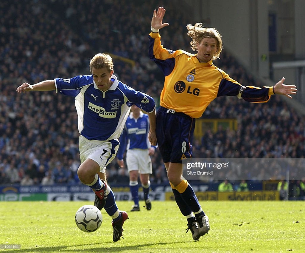 Niclas Alexandersson of Everton goes past Robbie Savage of Leicester during the Everton v Leicester City FA Barclaycard Premiership match at Goodison Park, Everton. DIGITAL IMAGE Mandatory Credit: CLIVE BRUNSKILL/Getty Images